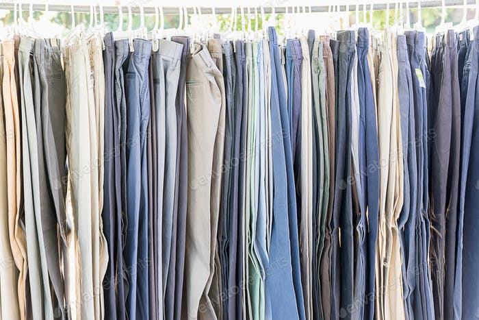 Row of old various woolen trousers_