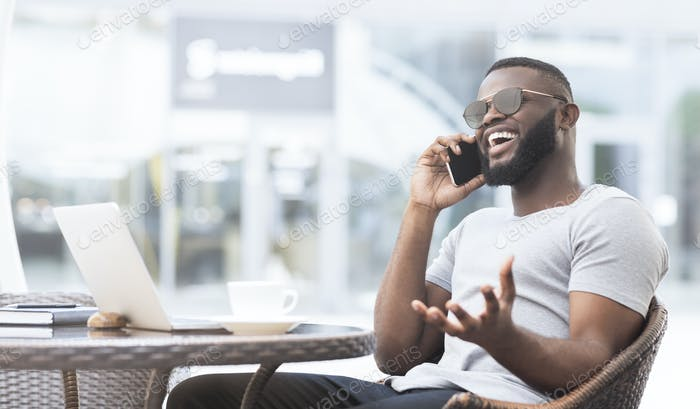 Handsome african guy have an emotional conversation