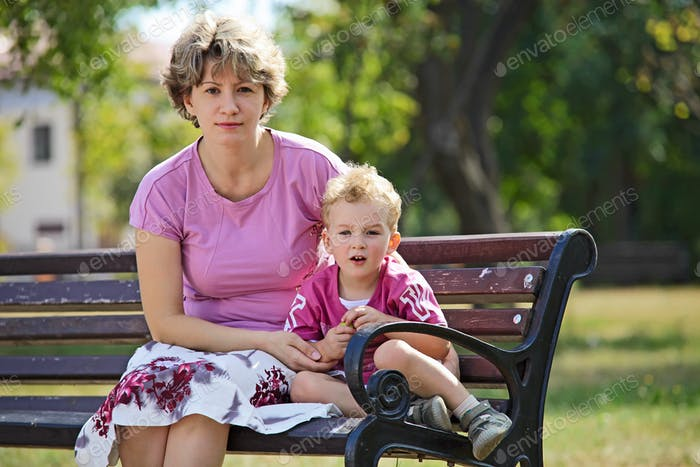 Portrait of a young woman and her son outdoors
