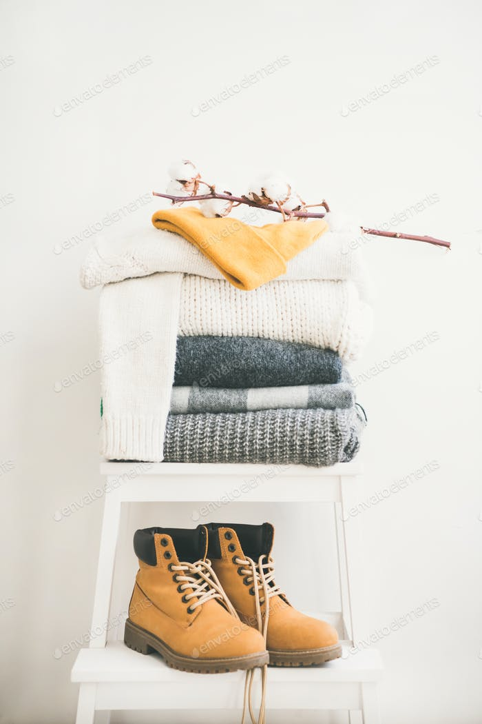 Warm clothing, blankets, boots and cap for winter or fall