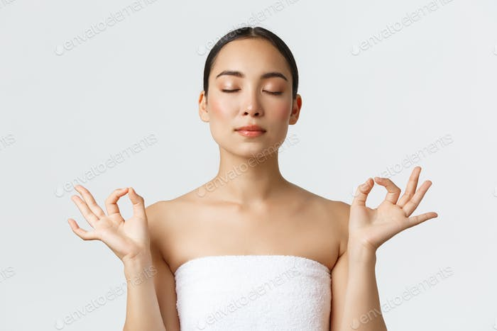 Beauty, cosmetology and spa salon concept. Close-up of meditating relaxed beautiful asian female in