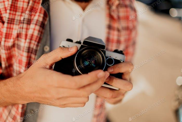 Focus on camera. Details.