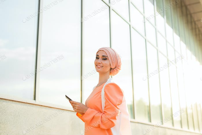 beautiful arabian girl with tablet computer. Muslim woman.