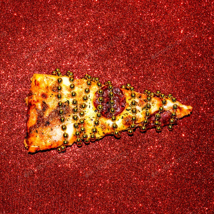 Slice of pizza on red sequins. Fast Food Art Flat lay minimal