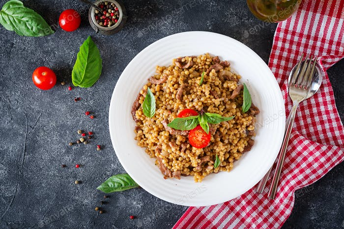 Israeli couscous with beef. Tasty food. Asian meal. Top view. Flat lay.