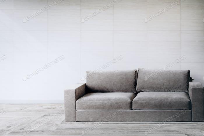 Graue Couch gegen eine Wand Mockup