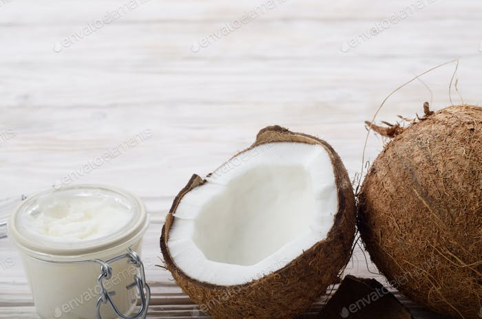 Background of coconut, coconut shell, hard oil in airtight glass
