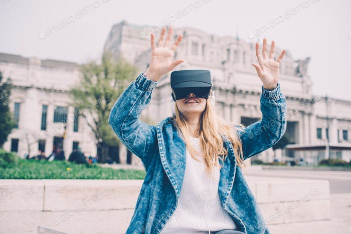 Business woman sitting using 3D viewer