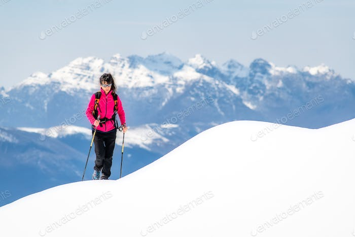 Young woman on ridge of so much snow