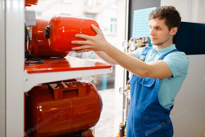 Plumber choosing expansion tank for water pump