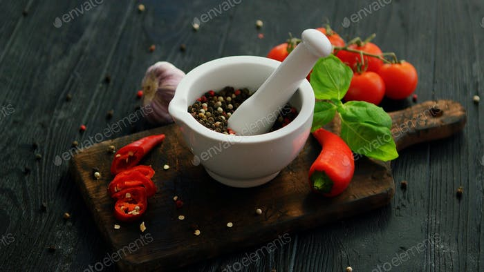 Bowl with spices on wooden cutting board