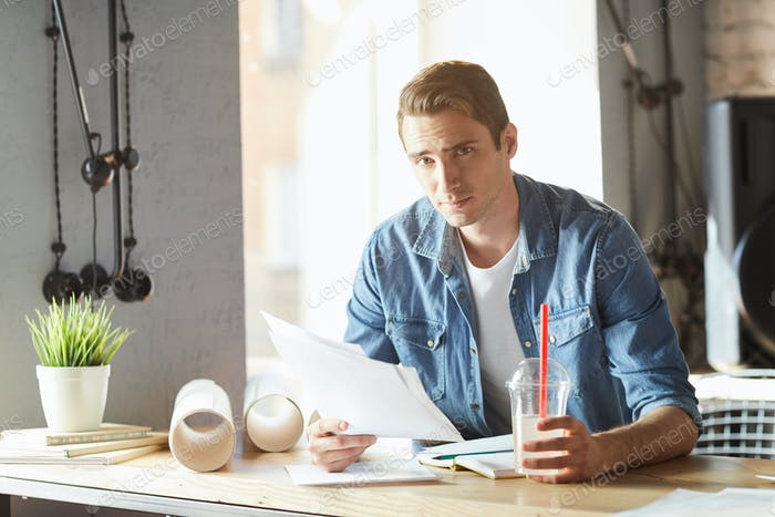 Handsome Young Businessman Working in Sunlight
