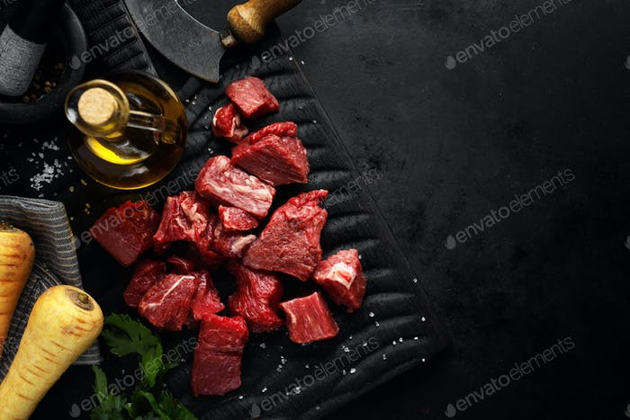 Beef chunks with ingredients served on table
