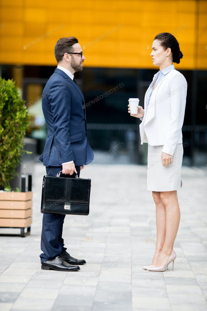 Business man and woman having dialogue on break