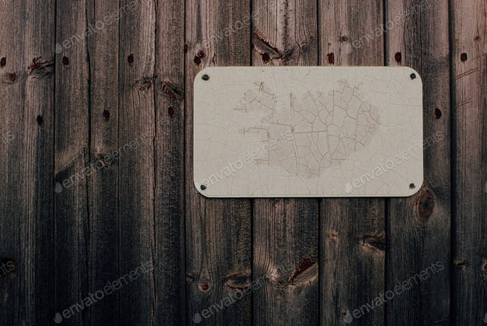Faded map of Iceland on wooden door
