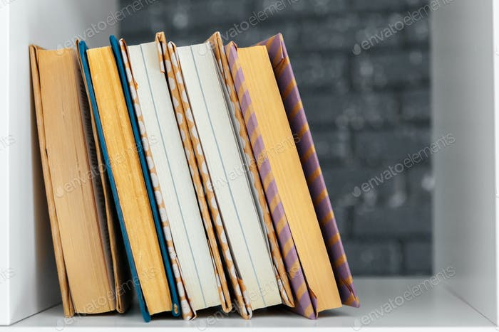 Stack of books on the table. creative photo