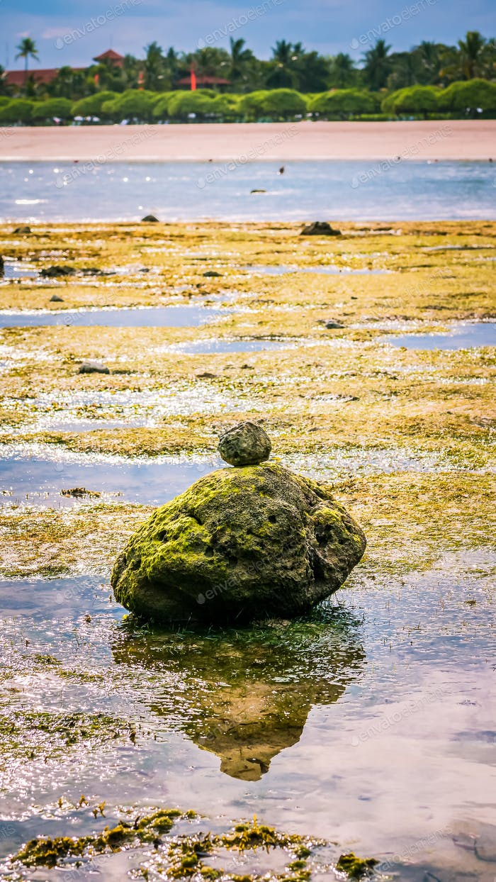 Zen-like Stones Covered with Moos on Beach during Low Tide, Nice Water Reflection, Nusa Dua, Bali