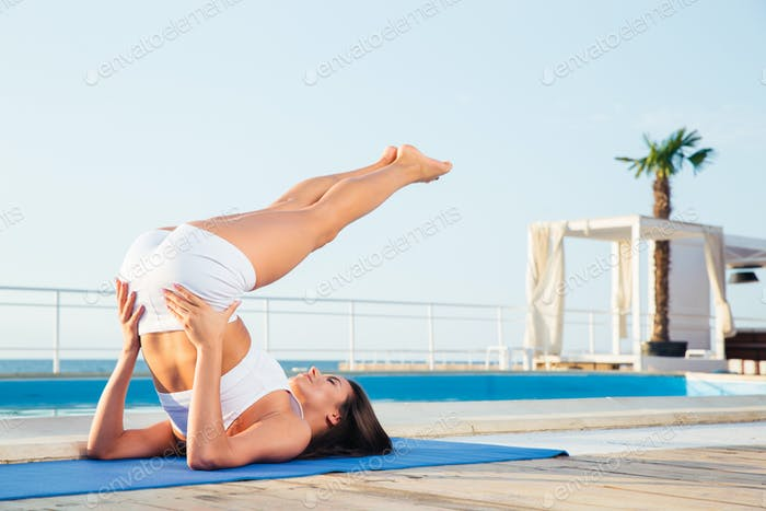 Girl making yoga exercises