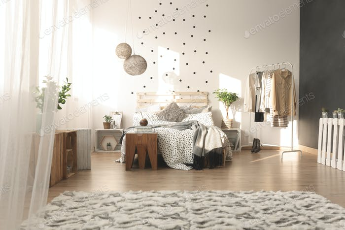 Bedroom with dot wall