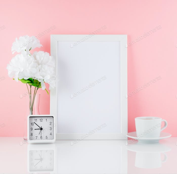 Blank white frame, flower, clock, cup of coffee