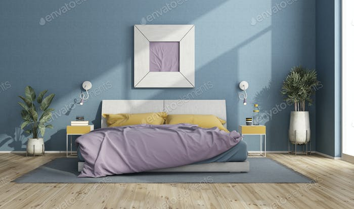 Colorful double bed in a modern room with blue walls