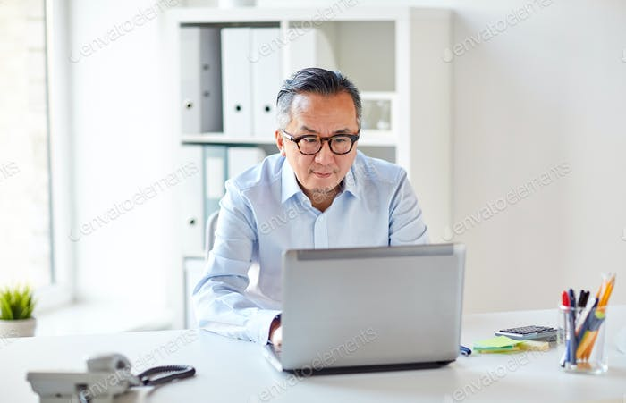 businessman in eyeglasses with laptop office