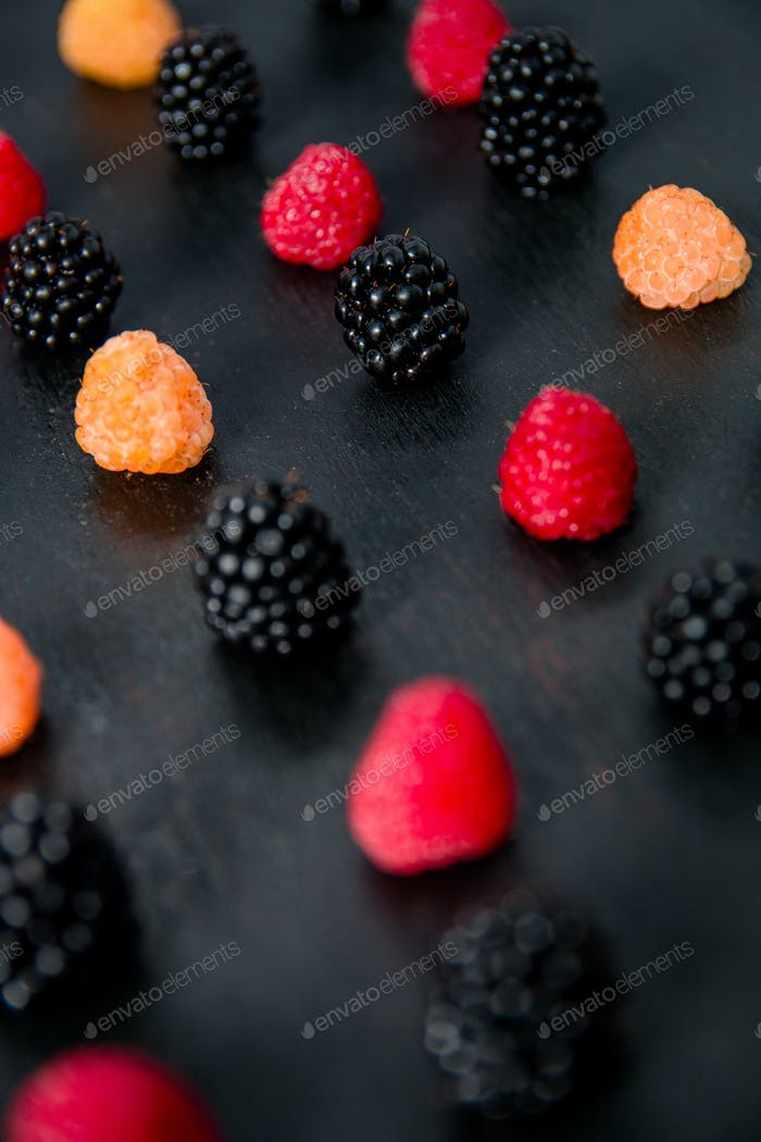 Thumbnail for Mixed of red, black, yellow raspberries on  table. Close up.
