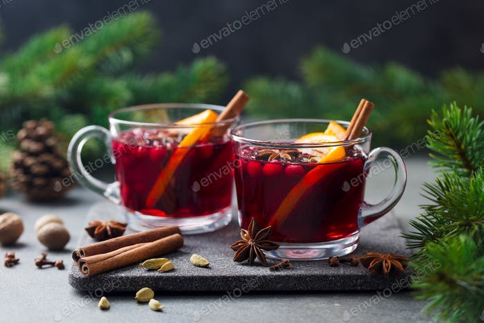 Mulled Red Wine with Spices. Christmas Decoration. Grey Stone Background.