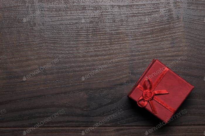 Red Present Box Over Wooden Background