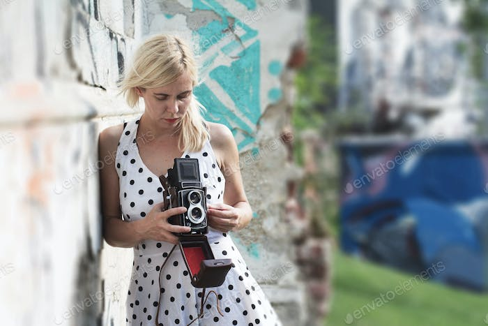 Young woman holding a medium format photography camera