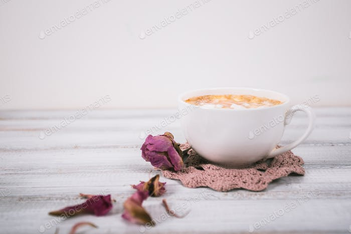 Red mug of coffee with marshmallow on wooden background