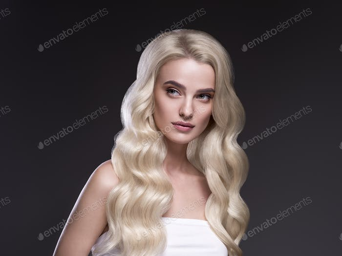 Blond hair woman long smooth hairstyle dark background beauty female