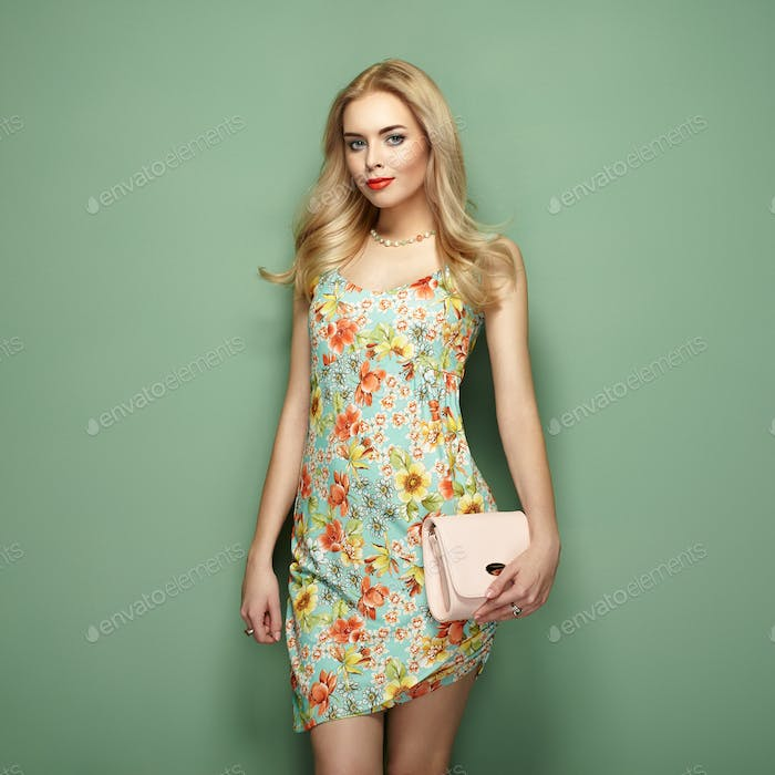 Blonde young woman in floral summer dress