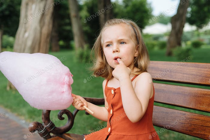 Cute Girl Eating Cotton Candy