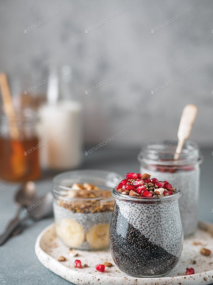 chia pudding set in different glass jars