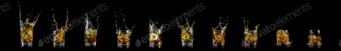 Collection of ten glass of splashing whiskey or other alcohol with ice cube