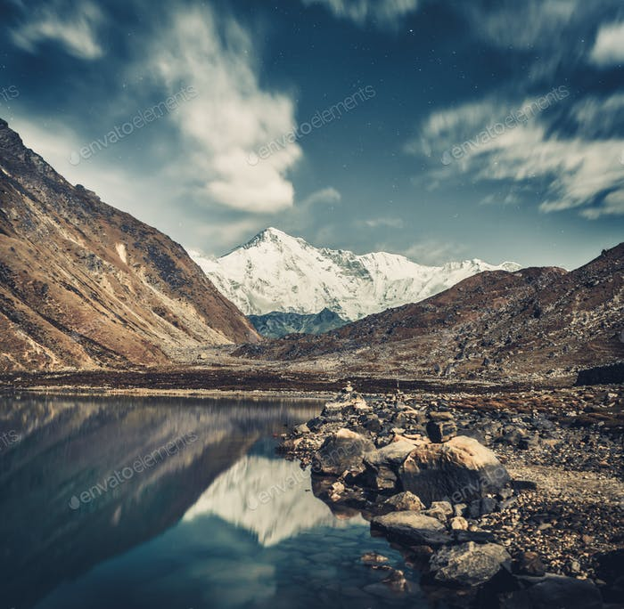 Gokyo Lake and the Himalayas in grey blue shades