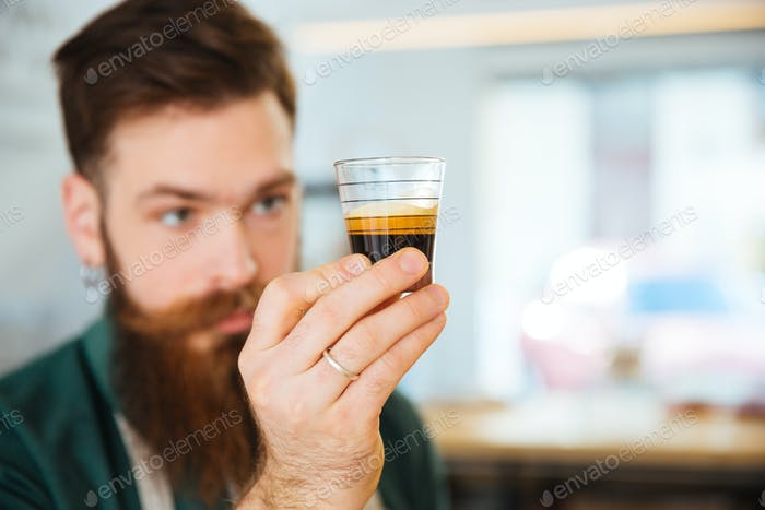 Barista holding glass with coffee