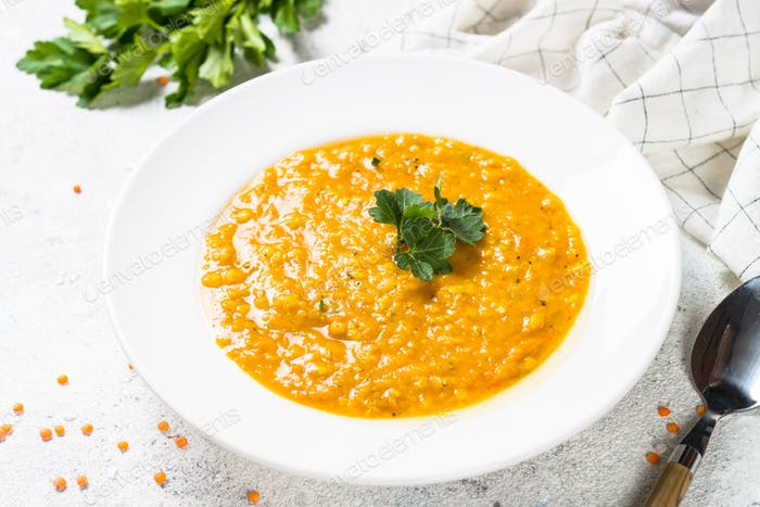 Red lentil soup on white top view