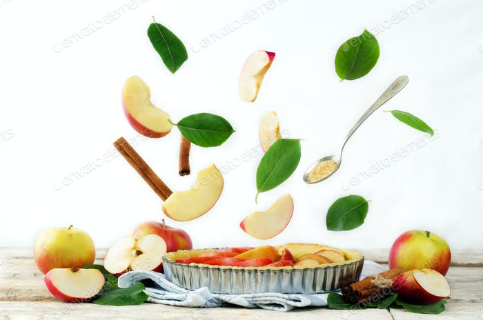 Apple cake with flying ingredients to bake it