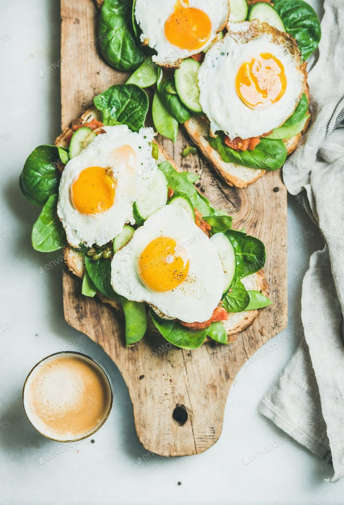 Healthy breakfast sandwiches and cup of coffee on board