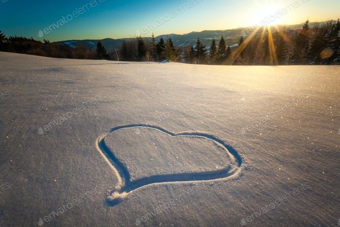 Heart trampled on the snow with feet