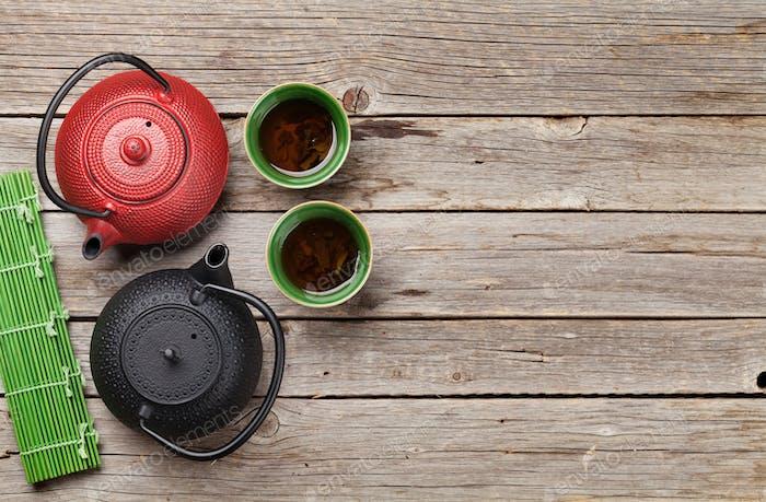 Herbal green tea and teapots