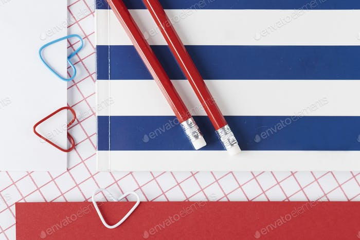 Red and blue accents of school supplies