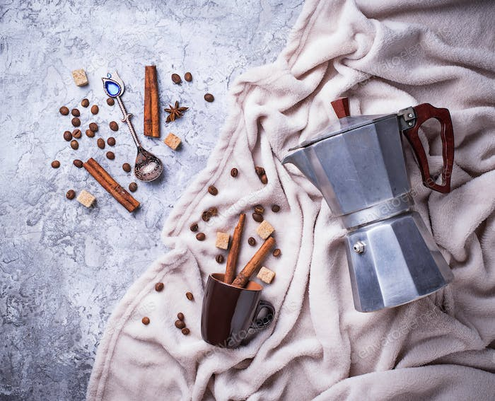 Creative coffee background with beans, sugar and ?offeepot. Flatlay style