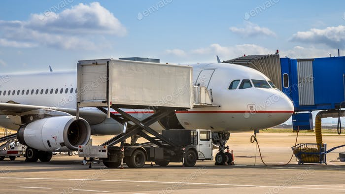 Passenger jet airplane docked on airport gate