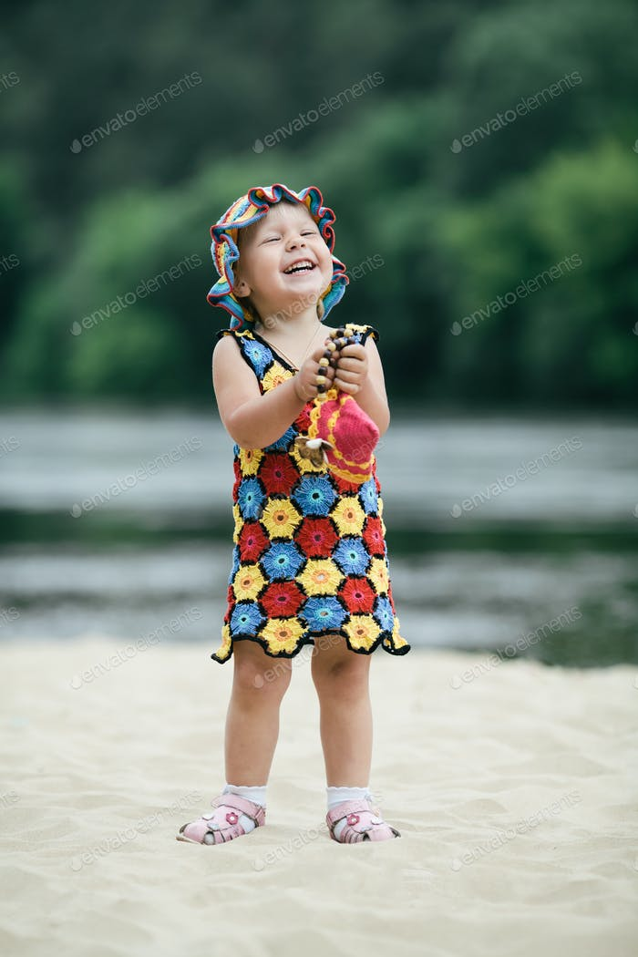 little girl with bright colorful dress