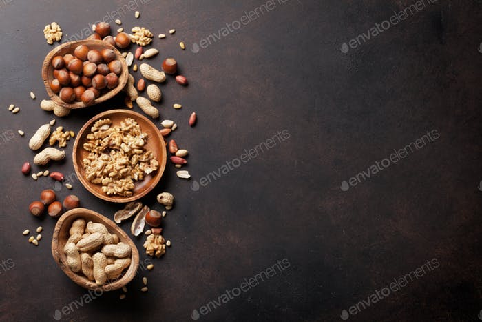 Various nuts on stone table
