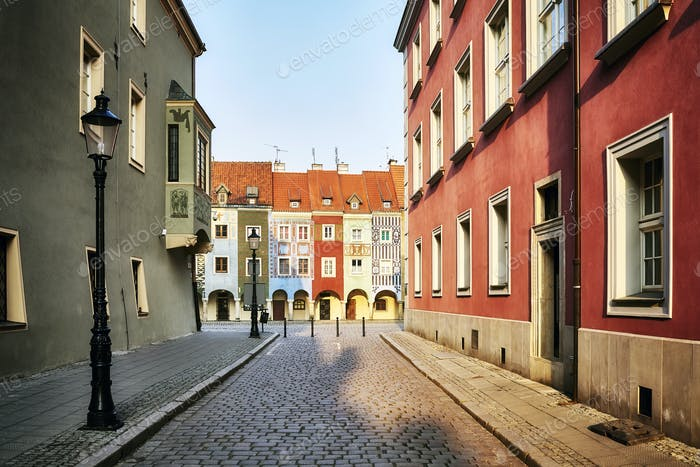 Street to the Poznan Old Market Square at sunrise, Poland.