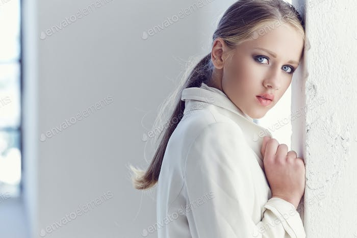 Portrait of young woman with blue eyes.
